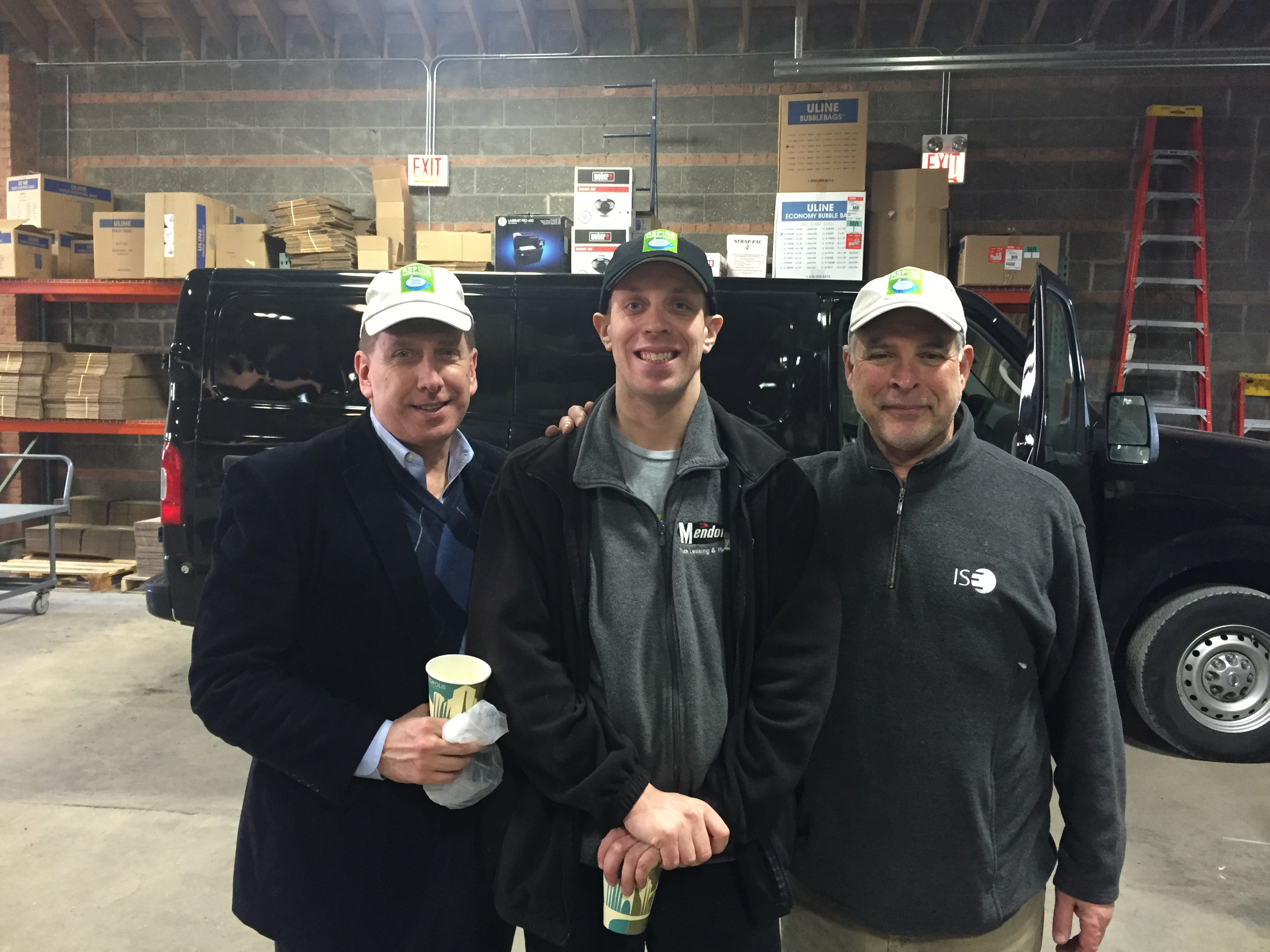 Orrin Huebner with Ben Rankin-Parker who works at Aspire CoffeeWorks, and Jerry Kallas, the Managing Director of Aspire CoffeeWorks, at Metropolis in Avondale.